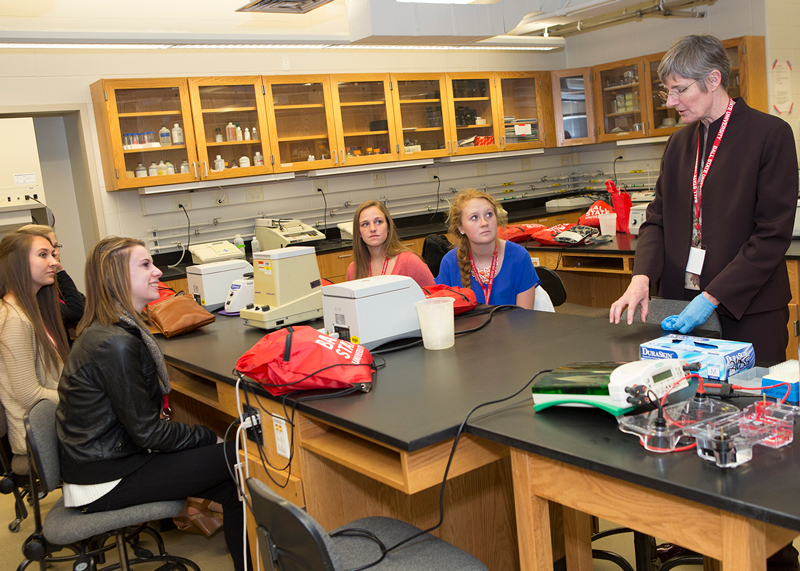 Sue McDowell, associate professor of biology, talks to students