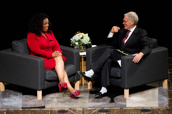 David Letterman and Oprah Winfrey chat on stage at Emens Auditorium