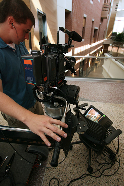 A camera operator videotapes inside the David Letterman Communication and Media Building