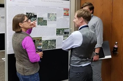 Archaeologist, Christine Thompson, presenting poster