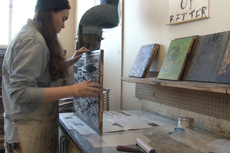 female student works on her printmaking project