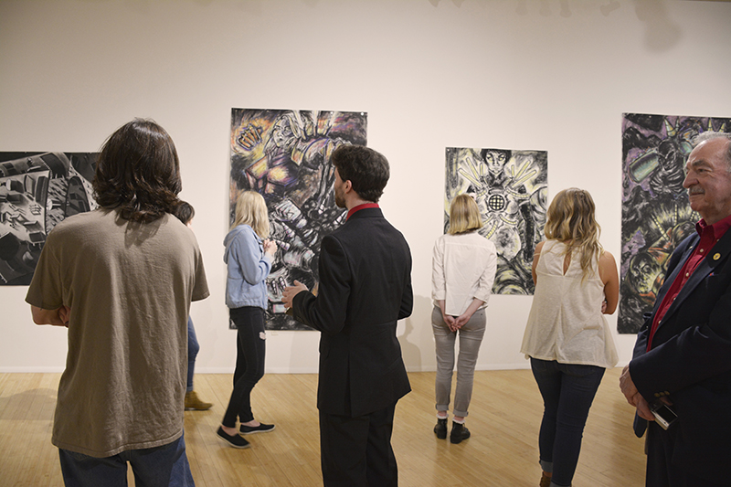 students in the atrium art gallery