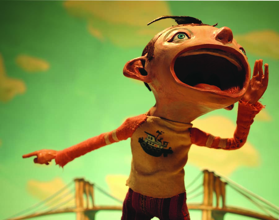 Image of one of Chris Sickels' stop-motion illustrations, showing a puppet of a young man yelling and motioning against a sky with clouds.