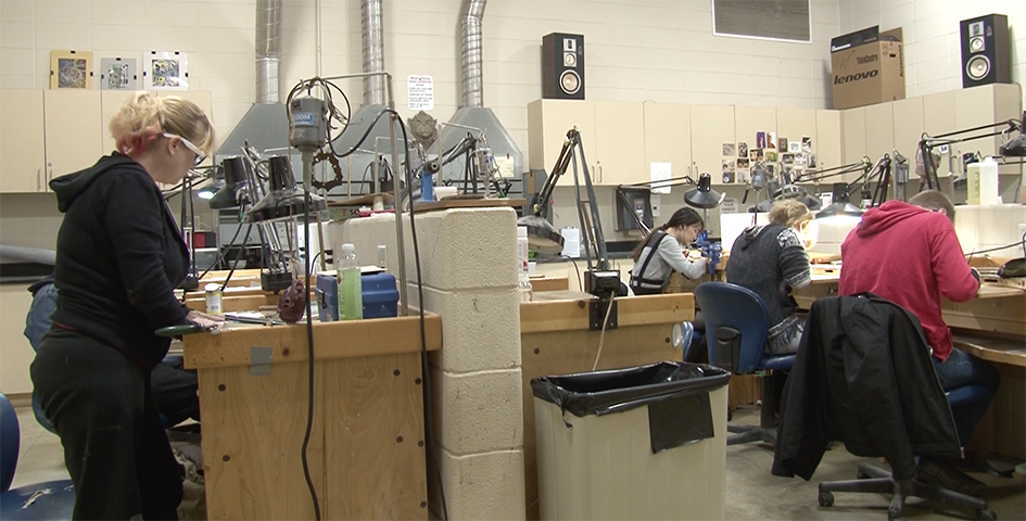 student working in the metals studio