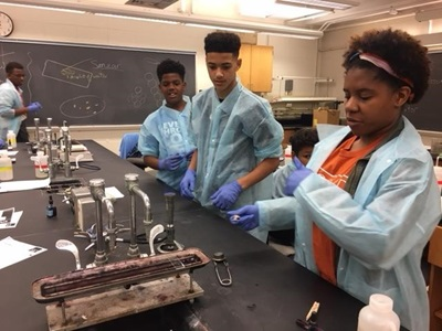 Photo of High School Students Conducting Experiment in Lab