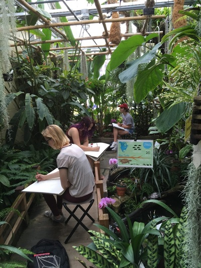 Image of people at the Rinard Orchid Greenhouse