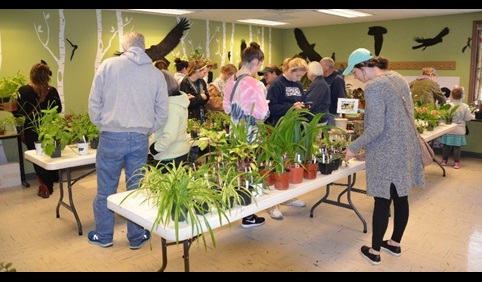 Image of group of people at the Rinard Orchid Greenhouse