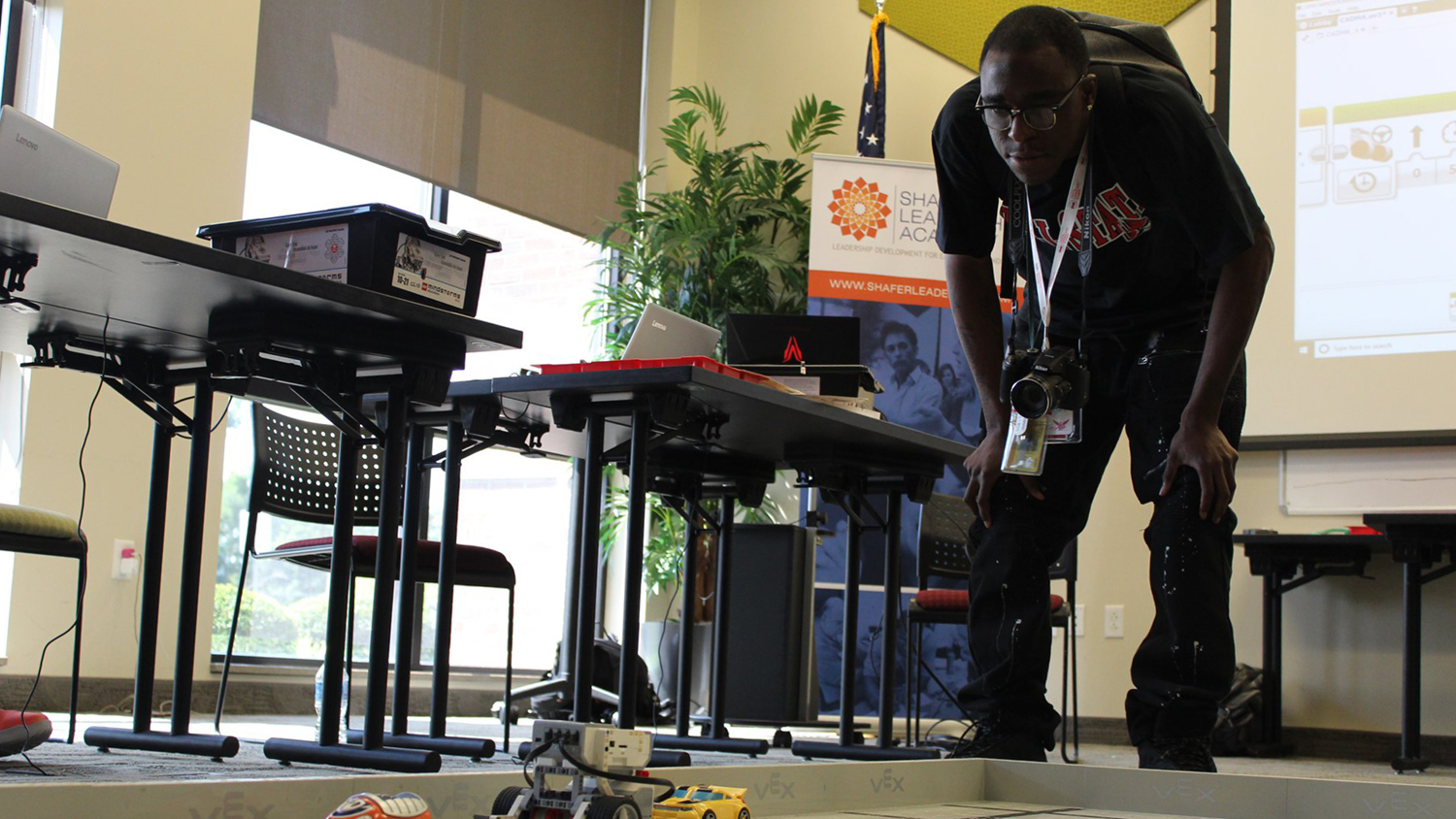 A student watches his robotics closely