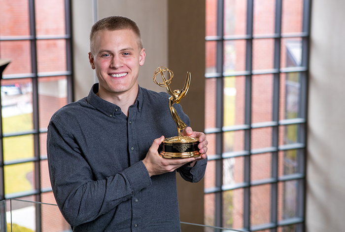 TCOM Student with Emmy Award