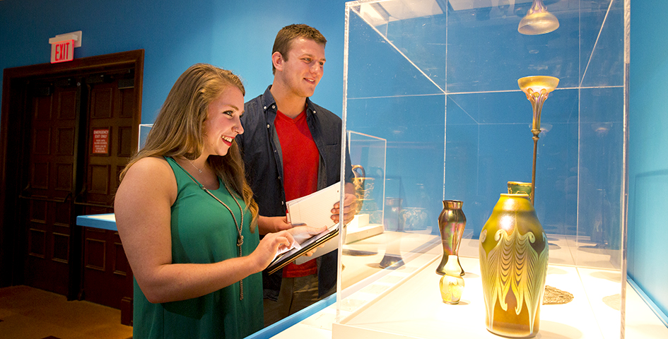 students browse an exhibit at the museum of art