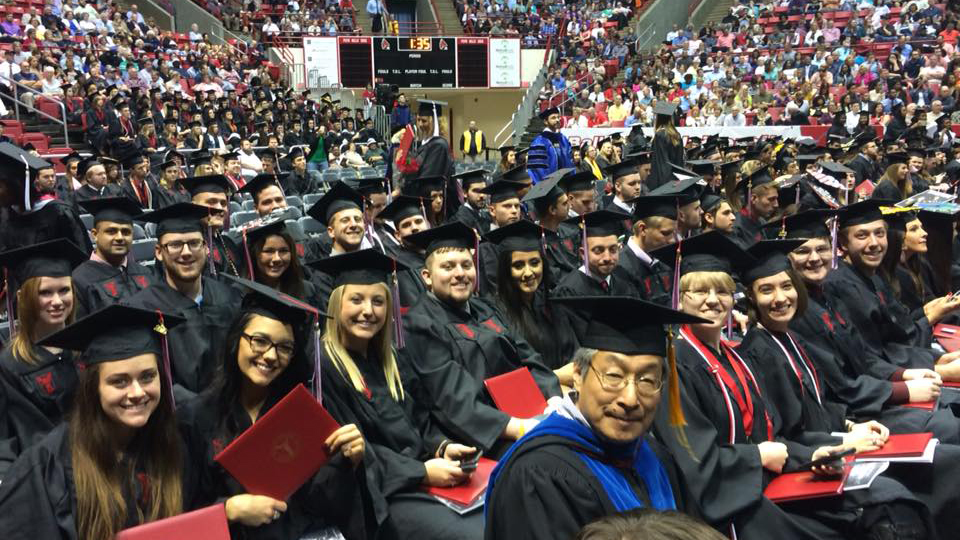 Students and faculty at commencement in Worthen Arena