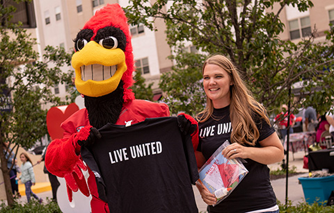 Charlie Cardinal and a girl with Live United t-shirts