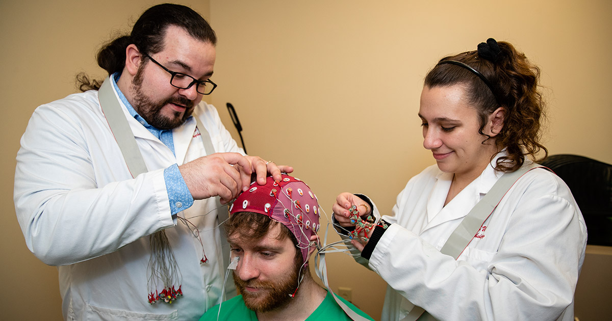 Graduate Counseling Psychology students work in the lab