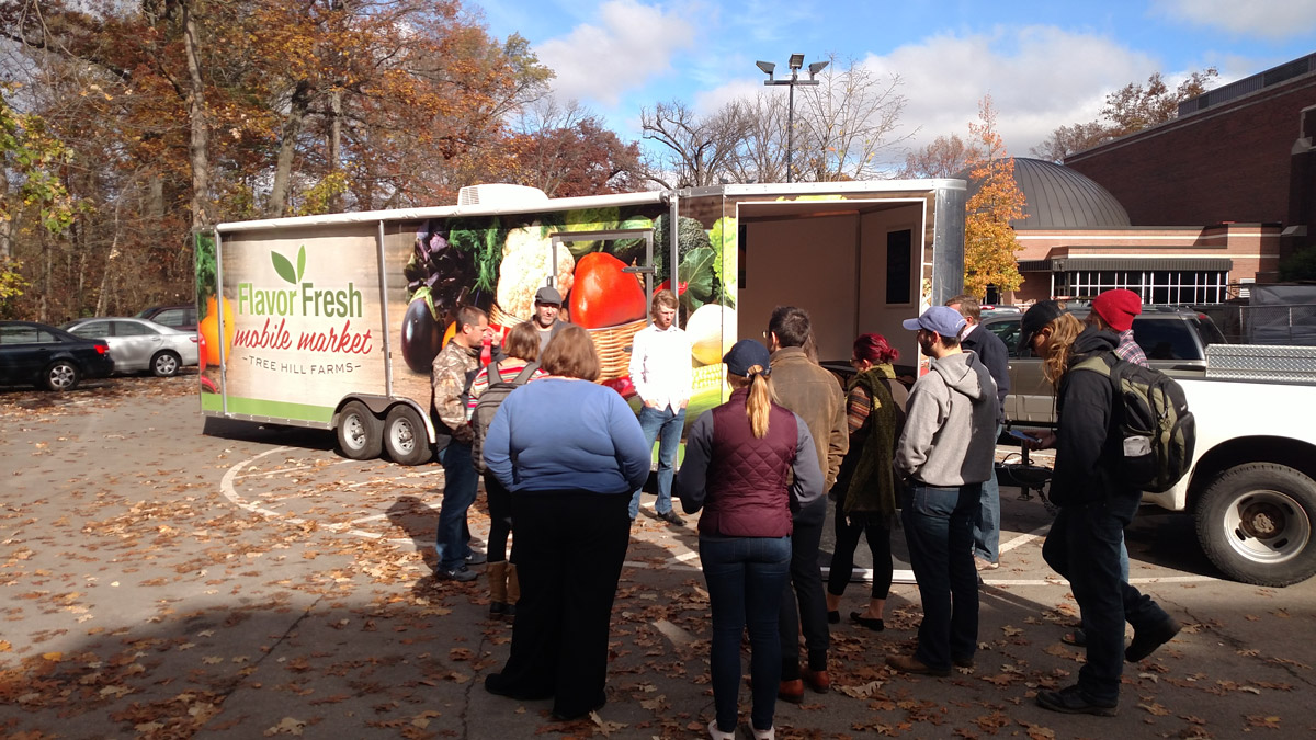 Students gather around a mobile produce truck