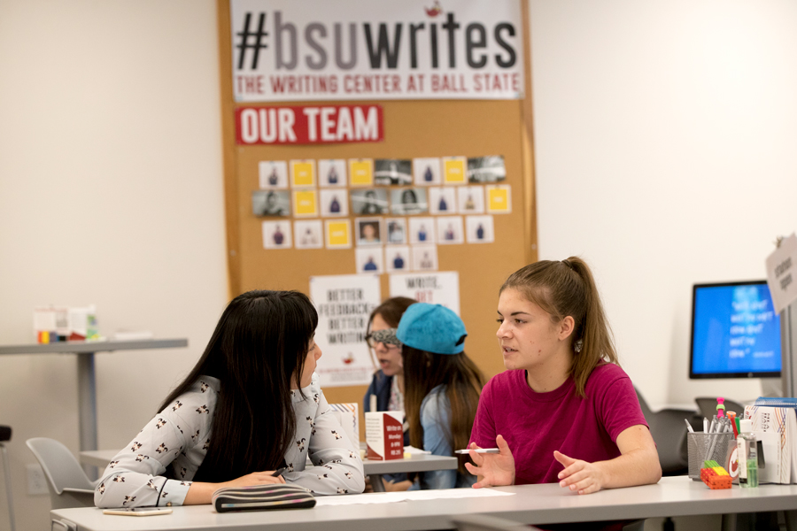 two female students talking in the Writing Center