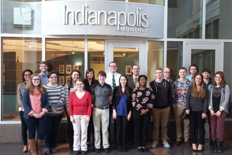 Students standing in front of Indianapolis Monthly offices