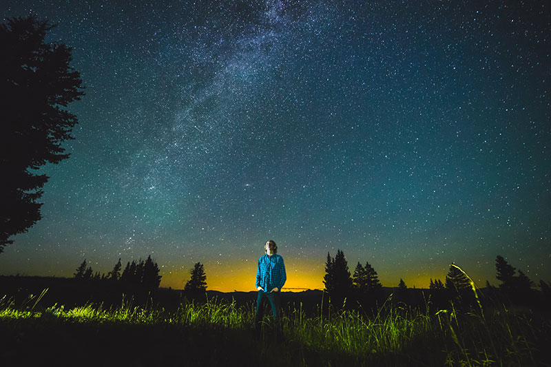 A person staring up at the night sky.