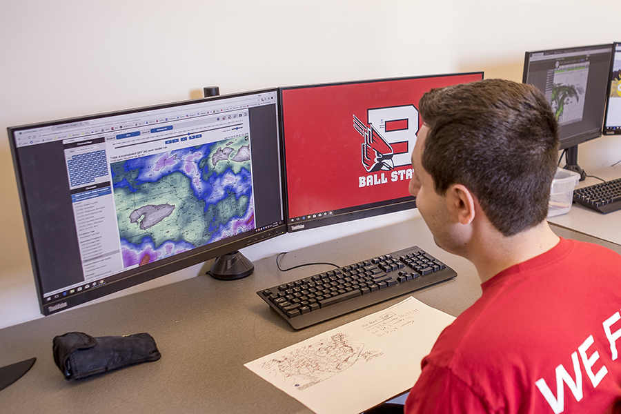 A student uses University software to forecast storms