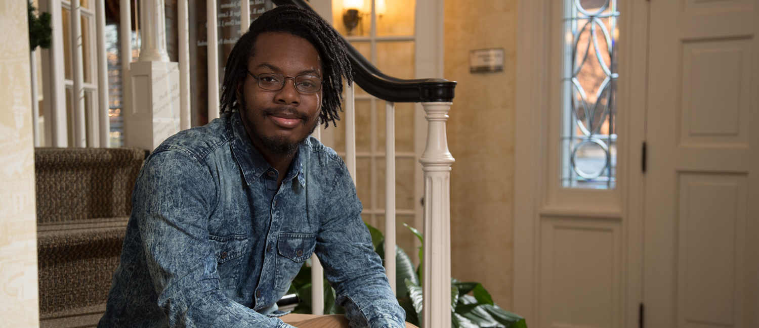 Lavonte Pugh, honors student inside the front door to the Honors House