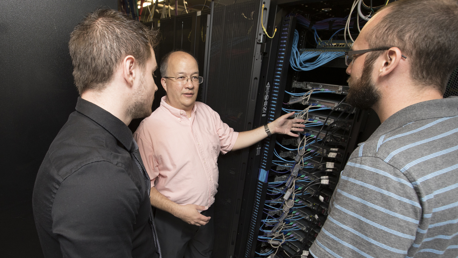 Professionals work with University servers