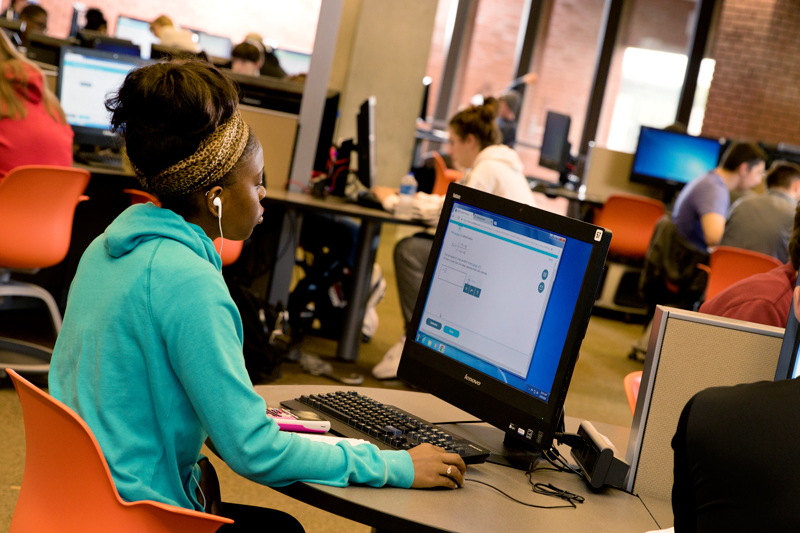Student uses a computer at Bracken Library