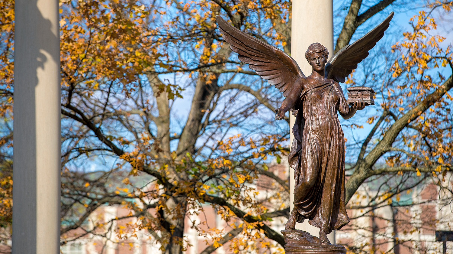 Beneficence statue in the fall