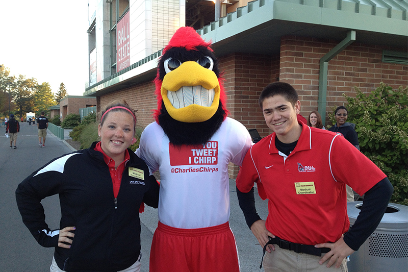 Charlie Cardinal with two Ball State students.