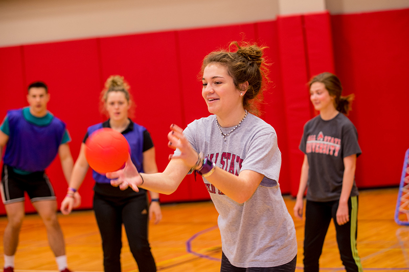 Ball State Kinesiology students play a game with a ball.