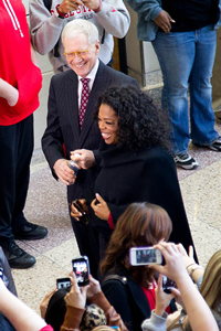 David Letterman and Oprah Winfrey walk together past students on Ball State's campus