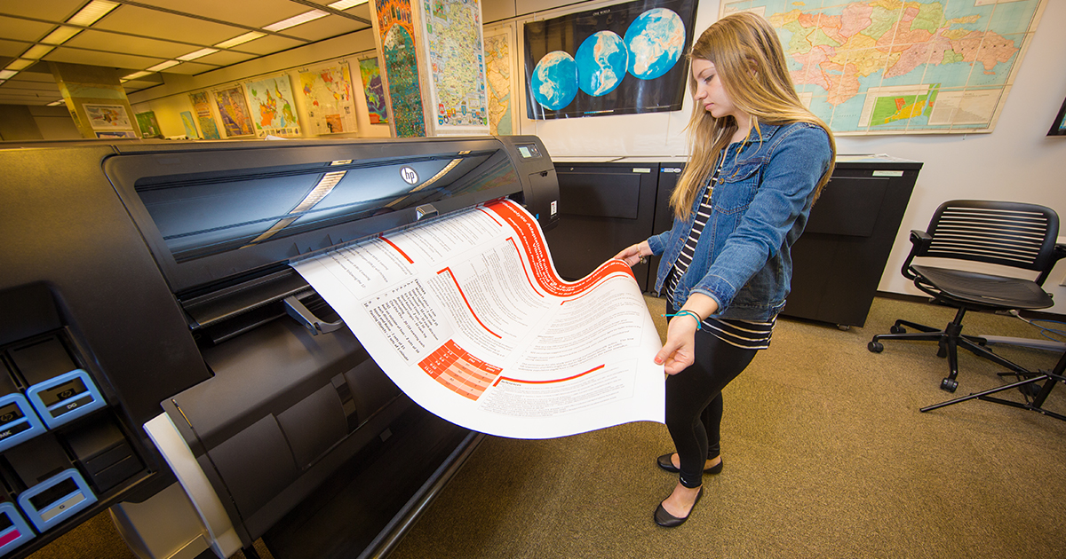 A student prints out a large document at the library