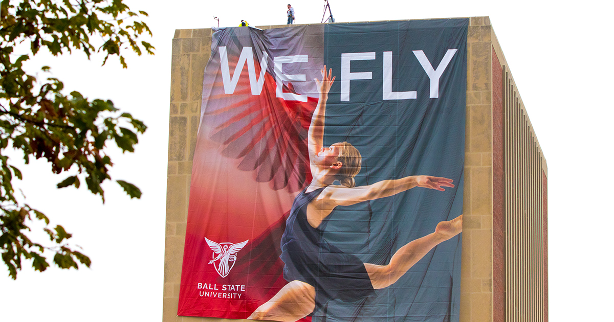 Teachers College with 'We Fly' banner