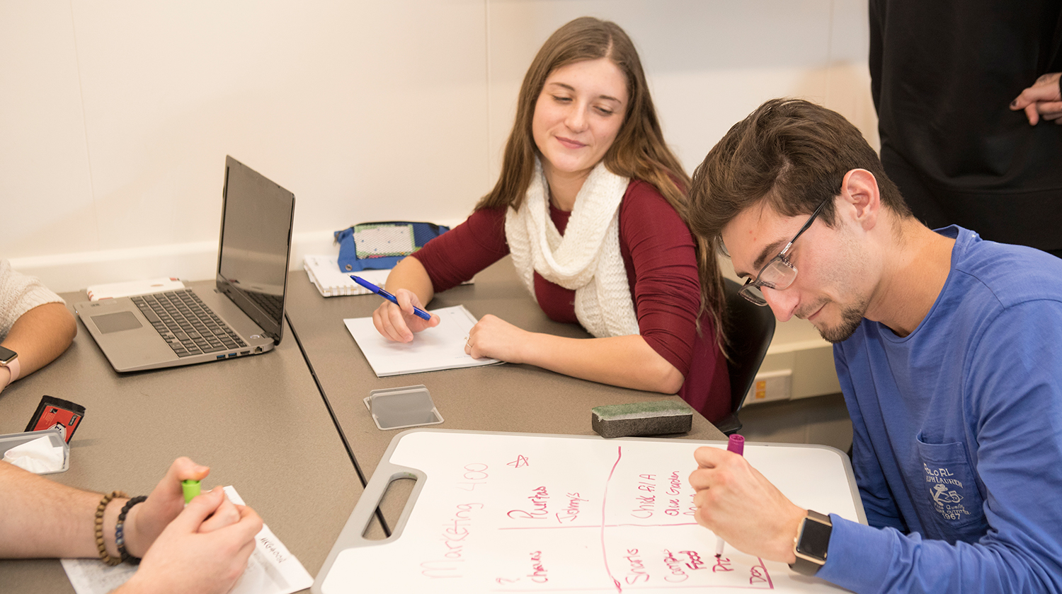 A group of students working together in a classroom.