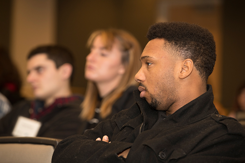 A sales student listens to a lecture.