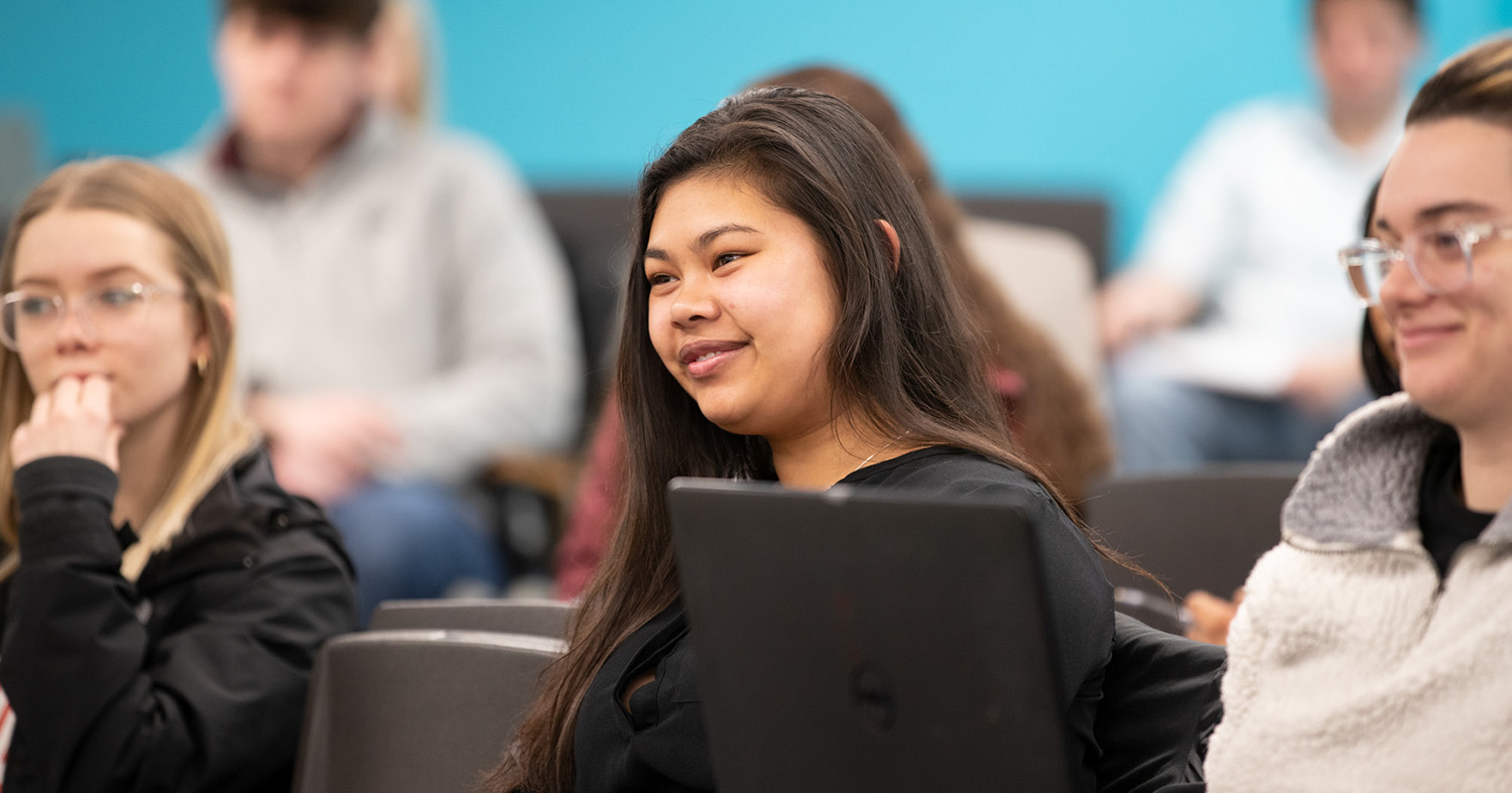 Students smiling during a lecture.