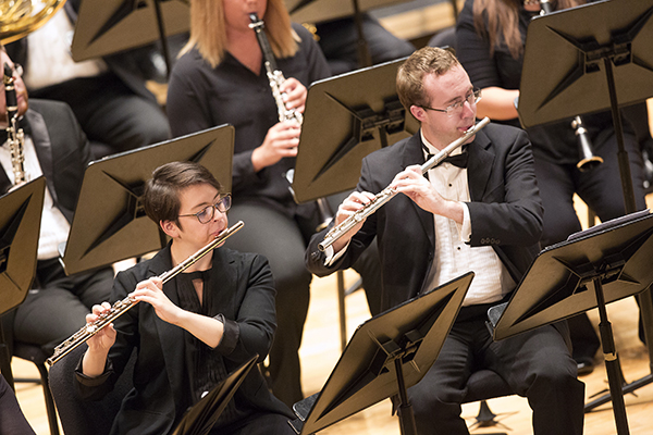 students playing flutes on stage