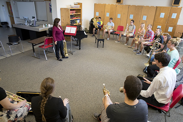 instructor and students in class with instruments
