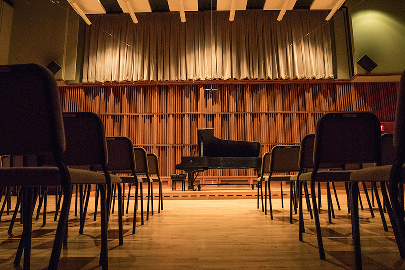 piano and chairs inside Hahn Recital Hall