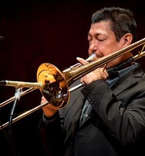 Freddie Mendoza performing trombone during a recital