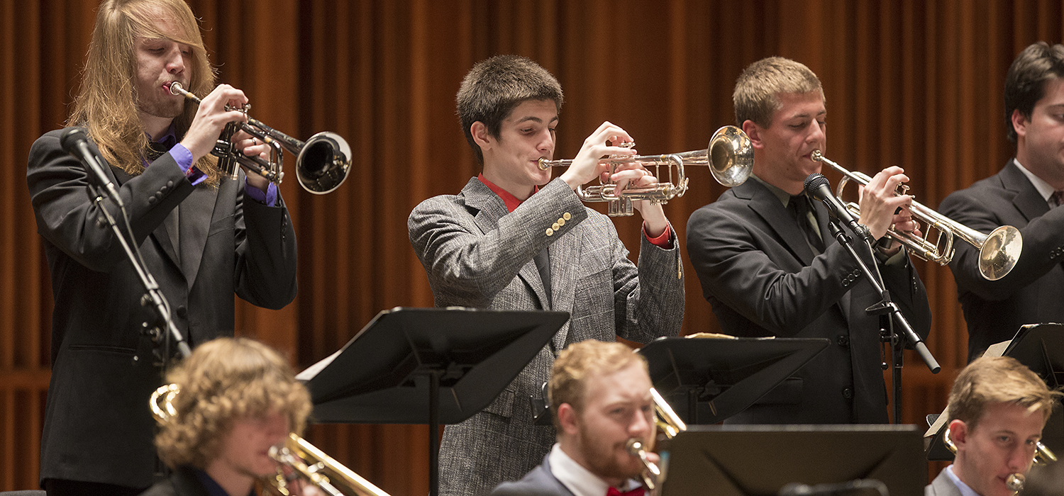 student trumpet players perform on stage
