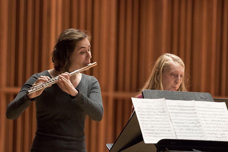 students play flutes on stage