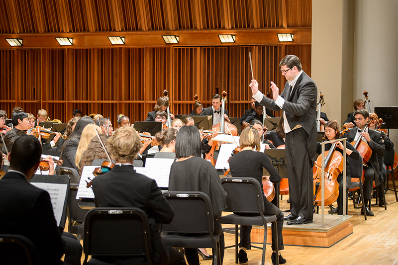 Symphony Orchestra with conductor on stage