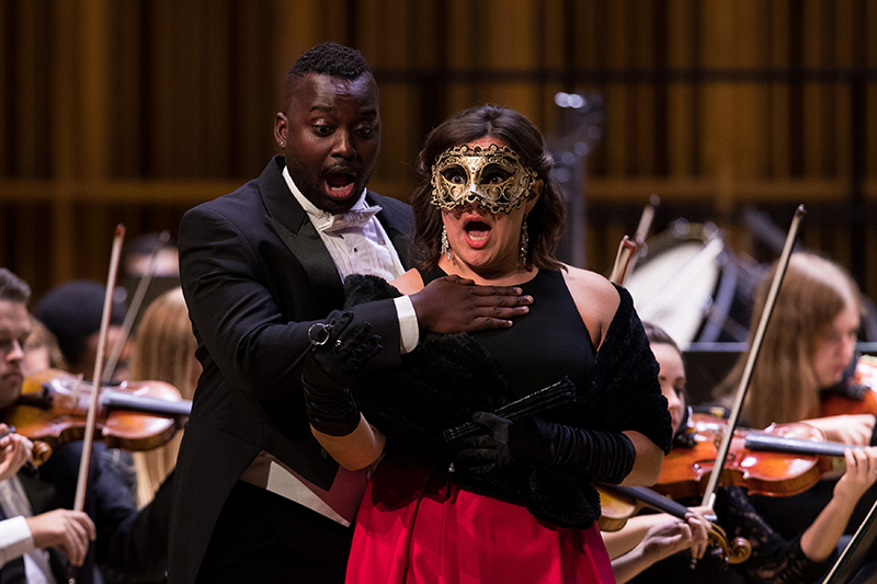 students perform an opera on stage
