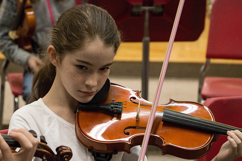Muncie Symphony Orchestra student playing violin