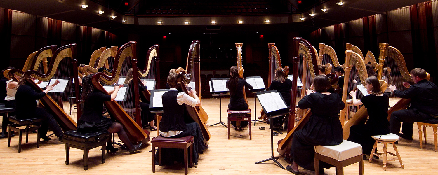 harp ensemble from the rear on stage