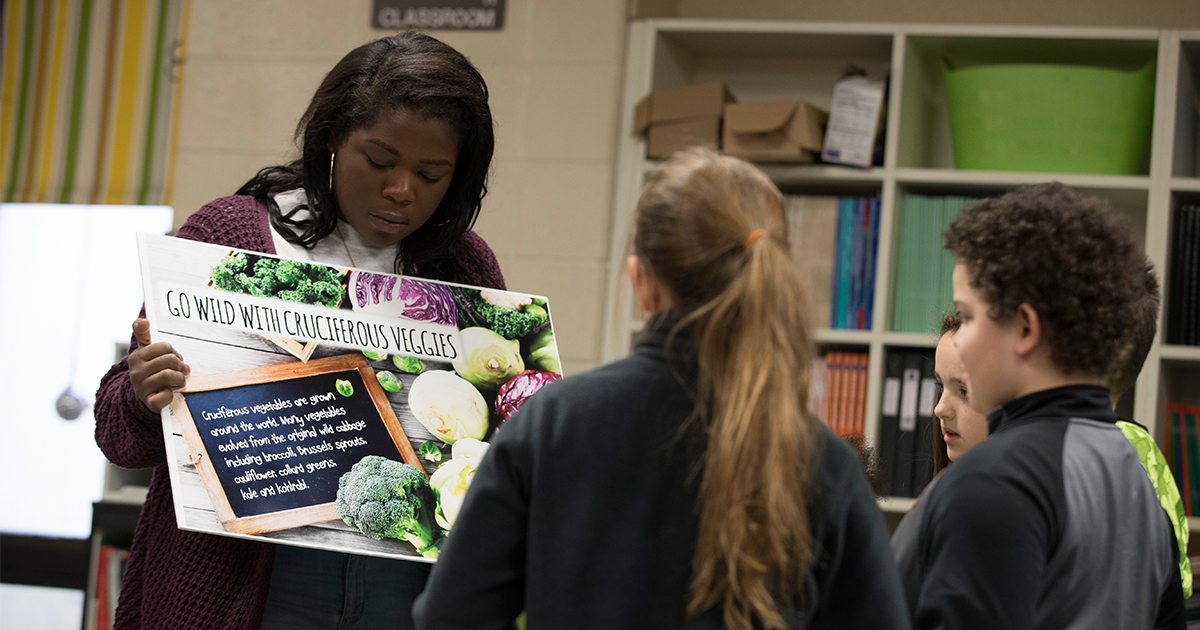 A Ball State student teaches other students about health.