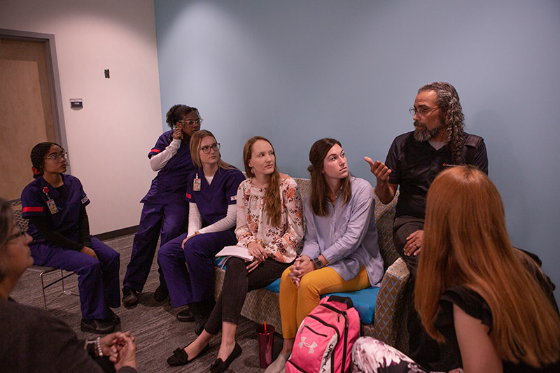 Students from different College of Health disciplines gather togethered