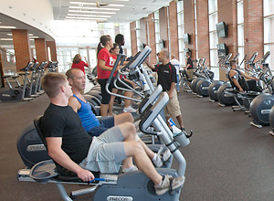 Photo of people using gym equipment