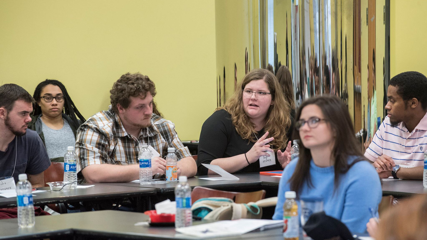students discussing in a classroom
