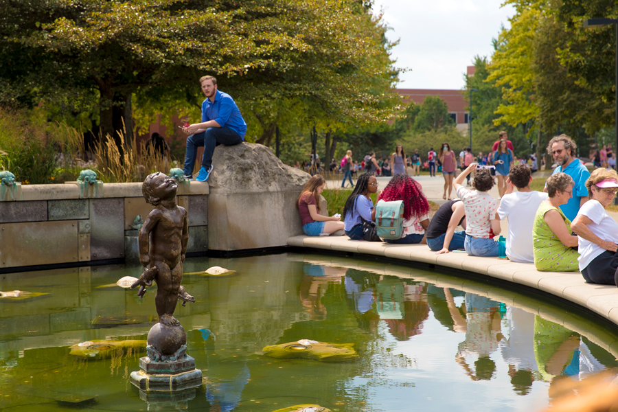 students and families at Frog Baby fountain