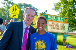 Student with President Mearns, smiling at camera
